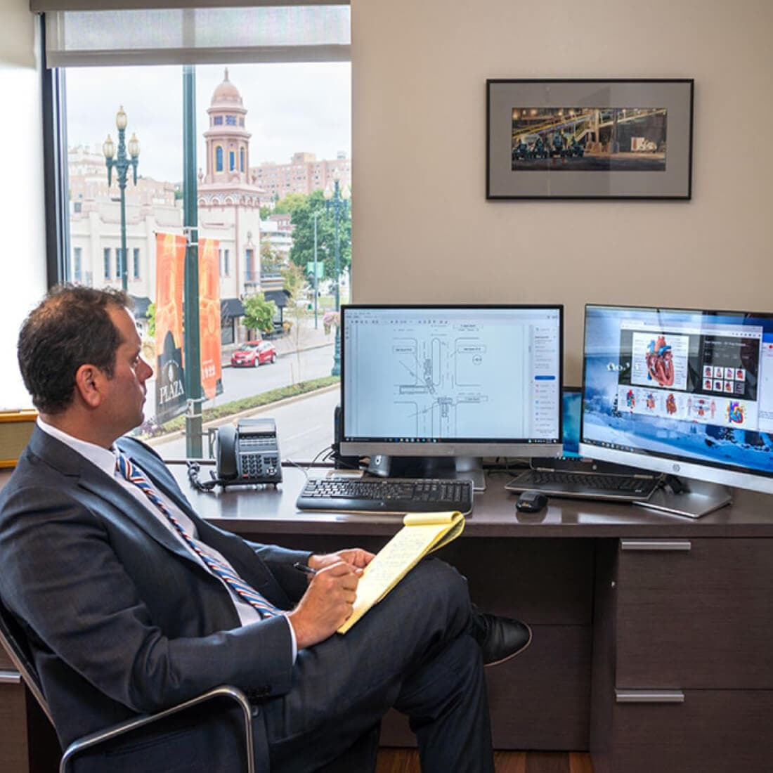 Image of an attorney working in his office